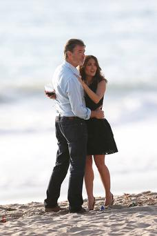 Pierce Brosnan is snapped kissing Salma Hayek on set, the day after smooching with Jessica Alba.