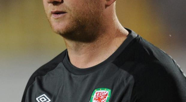 John Hartson has resigned as Wales assistant coach