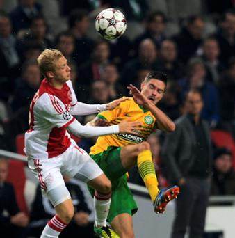 Ajax Amsterdam's Nicolai Boilesen (L) challenges Celtic's Mikael Lustig (R) during their Champions League soccer match.