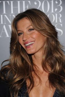 "Top model Gisele Bündchen smiles on the red carpet as she attends WSJ. Magazine's ""Innovator Of The Year"" Awards 2013 in New York City. (Photo by Dimitrios Kambouris/Getty Images)"