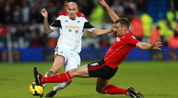 Swansea City's Jonjo Shelvey is tackled by Cardiff City's Ben Turner during last weekend's game
