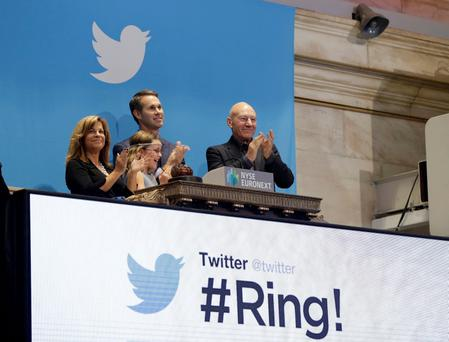 Actor Patrick Stewart (R) and 9-year-old Vivenne Harr (C), who uses proceeds from her lemonade stand to fight slavery, ring the opening bell as Twitter co-founder Evan Williams and and Boston police officer Cheryl Fiandaca (L) look on during the Twitter IPO on the floor of the New York Stock Exchange