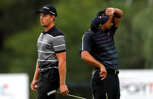 Tiger Woods and Henrik Stenson of Sweden on the 10th green during the first round of the inaugural Turkish Airlines Open in the south west city of Antalya