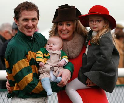 Tony McCoy with his daughter Eve (right), son Archie and wife Chanelle after victory in the Weatherbys Novices Hurdle at Towcester Racecourse, Northamptonshire