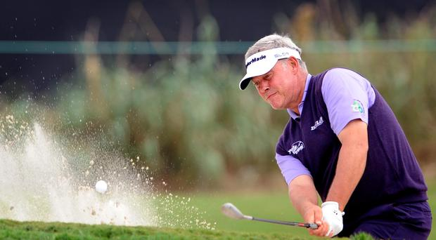 Darren Clarke hits out of the 17th bunker during the first round of the McGladrey Classic golf tournament in St. Simons Island, Georgia. (AP Photo/Stephen Morton)