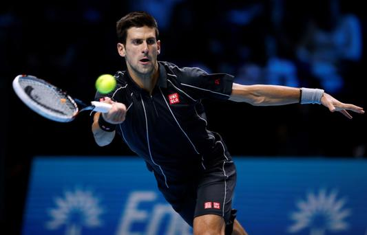Novak Djokovic competes against Juan Martin Del Potro during day four of the Barclays ATP World Tour Finals at the O2 Arena, London