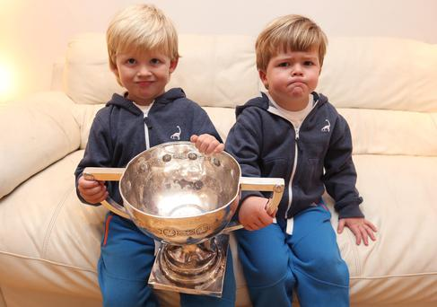 Bobby and Sam, aged 4 hold the trophy which their uncle, Ger Brennan, captain of St Vincent's won after victory in the county final at Parnell Park.