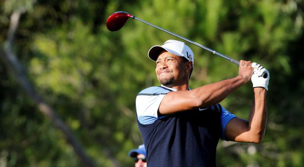 Tiger Woods plays a shot on the 12th hole during the delayed first round of the inaugural Turkish Airlines Open in the south west city of Antalya today