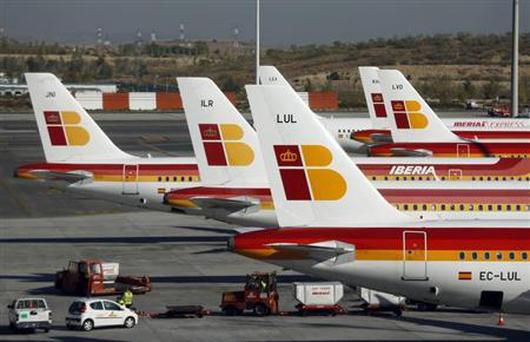 Passenger planes of Spain's flagship Iberia airline are parked at Terminal 4 of Madrid's Barajas airport October 18, 2013. REUTERS/Sergio Perez