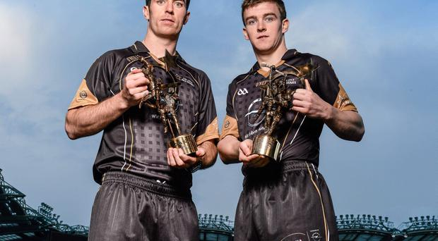 Dublin footballer Michael Darragh Macauley and Clare hurler Tony Kelly with their 2013 GAA GPA All-Star Player of the Year awards