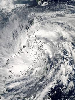 Super-Typhoon Haiyan moves over the central Philippines in this NASA satellite image