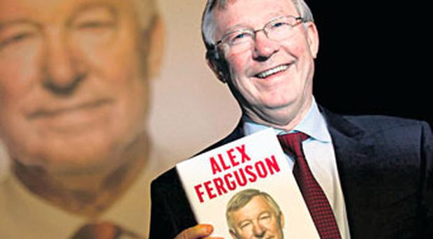 Alex Ferguson, pictured with his biography, attending a function at the convention centre in Dublin