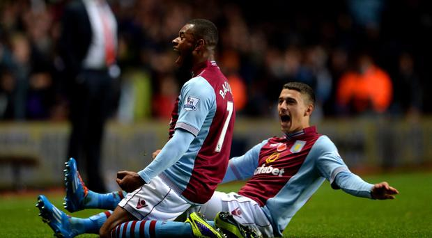 Leandro Bacuna (L) of Aston Villa celebrates with teammate Matthew Lowton after scoring the opening goal of the game