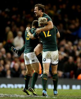 Bismark Du Plessis celebrates with Jean De Villiers and try scorer Fourie Du Preez