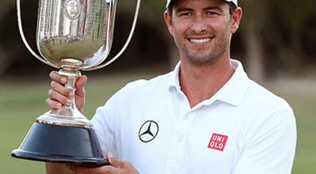 Adam Scott of Australia celebrates with the trophy after winning the Australian PGA golf championship