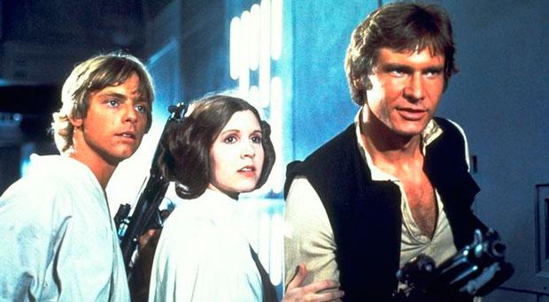 The iconic cast of the first Star Wars release: Mark Hamill as Luke Skywalker, Carrie Fisher as Princess Leia and Harrison Ford as Han Solo. Followed by 'The Empire Strikes Back' and 'Return of the Jedi,' this was the first of a groundbreaking trilogy. More than 20 years later George Lucas would revisit the Star Wars universe, producing a series of three prequels. In keeping with the new chronology, the first release was renamed 'Episode IV: A New Hope.'