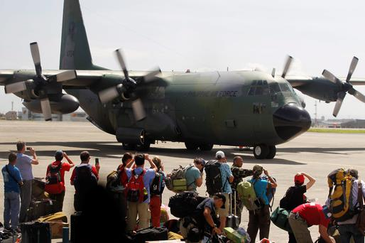 Local and foreign medical teams prepare to board a Philippines air force C-130 transport plane in Manila, Philippines in search of victims in the areas devastated by Typhoon Haiyan.
