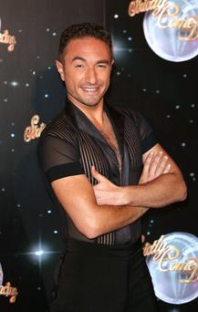 The former Strictly star danced around the camp in a pair of leopard print trunks. (Photo by Tim Whitby/Getty Images)