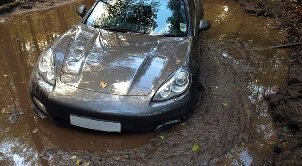 This photo posted on Twitter shows the car stuck in a muddy puddle