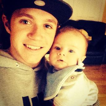 The star shared this photo of himself and his godson Theo. (Instagram/Niall Horan)
