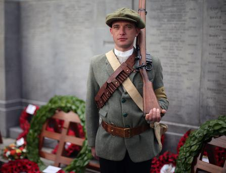 Samuel Stewart dressed as a UVF volunteer from the Last Post Great War Society in Belfast takes part in a cross border wreath laying ceremony at the cenotaph in Glasnevin Cemetery in Dublin to mark the 95th anniversary of World War One
