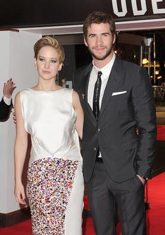 Jennifer Lawrence and Liam Hemsworth arriving for the World Premiere of The Hunger Games.