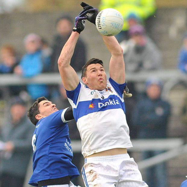 St Vincent's Eamon Fennell in action against St Loman's Willie McGovern. Picture credit: Pat Murphy / SPORTSFILE