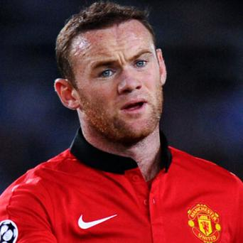 A receptionist at a Liverpool massage parlour receptionist told Wayne Rooney to get out 'before he was destroyed and his career was over', a jury has heard.