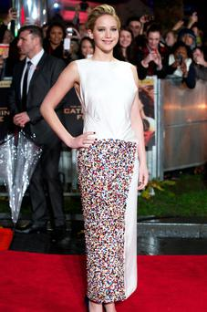US actress Jennifer Lawrence poses for pictures on the red carpet upon arrival for the world premier of the film