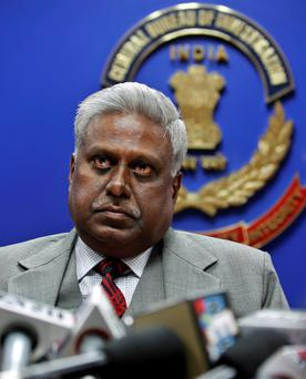 India's Central Bureau of Investigation (CBI) director Ranjit Sinha addresses a press conference at the CBI headquarters in New Delhi, India. The top police official is under fire for saying,