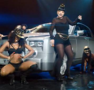 Lily 'does a Rihanna' as she is dressed in a raunchy outfit and dances alongside scantily-clad girls. (Photo/Youtube)