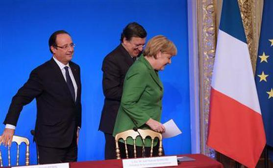 French President Francois Hollande (L) German Chancellor Angela Merkel (R) and European Commission President Jose Manuel Barroso leave after a news conference at the end of an international summit on youth unemployment attended by heads of states from EU countries at the Elysee Palace in Paris, November 12, 2013. REUTERS/Philippe Wojazer