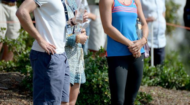 DUBAI, UNITED ARAB EMIRATES - NOVEMBER 15: Manchester United and England footballer Michael Carrick and tennis star Caroline Wozniacki of Denmark watching Rory McIlroy during the second round of the 2013 DP World Tour Championship on the Earth Course at the Jumeirah Golf Estates on November 15, 2013 in Dubai, United Arab Emirates. (Photo by Ross Kinnaird/Getty Images)