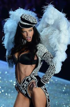 Adriana Lima walking in the 2013 Victoria's Secret runway show Photo: Getty