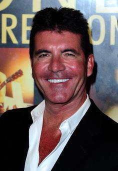 Simon Cowell has agreed a new deal with ITV which will see the X Factor and Britain's Got Talent on screen for a further three years