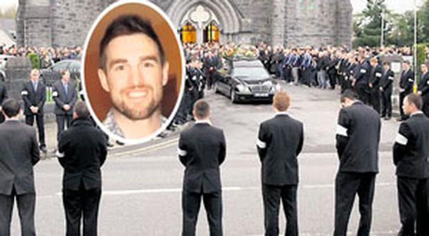 The remains of Alan Feeley (inset) are carried from St Colman's Church, Claremorris, Co Mayo, by his father Willie.