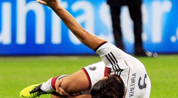 Germany's Sami Khedira reacts after injuring his knee during their international friendly soccer match against Italy at the San Siro last night