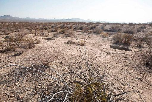 Two shallow graves are seen at the site on the outskirts of Victorville that contained the skeletal remains of members of missing McStay family.