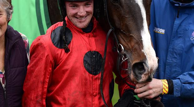 Jockey Richie McLernon (left) poses with John's Spirit after winning the Paddy Power Gold Cup Chase