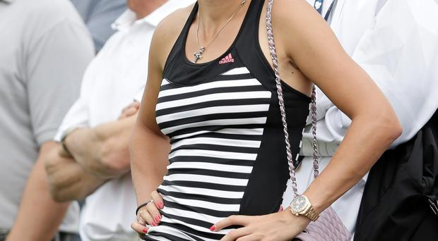 Rory McIlroy's girlfriend Caroline Wozniacki watches him play during the final round of DP World Golf Championship.