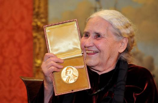 British novelist Doris Lessing is seen smiling as she poses with her Nobel Prize for Literature at the Wallace Collection in London in this January 30, 2008 file photograph. REUTERS/Toby Melville/Files