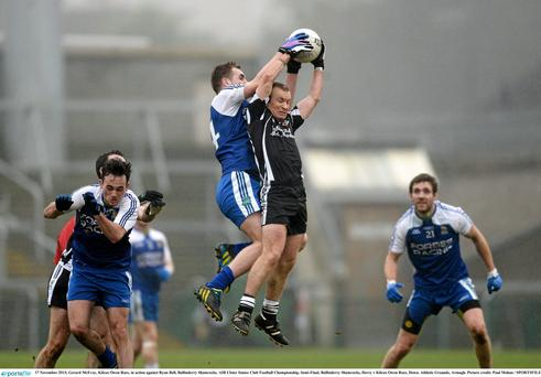 17 November 2013; Gerard McEvoy, Kilcoo Owen Roes, in action against Ryan Bell, Ballinderry Shamrocks. AIB Ulster Senior Club Football Championship, Semi-Final, Ballinderry Shamrocks, Derry v Kilcoo Owen Roes, Down. Athletic Grounds, Armagh. Picture credit: Paul Mohan / SPORTSFILE