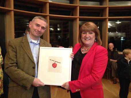 Author Dermot O'Neill Presenting Pauline Finn with her prize; 'Malus' By Cliona Doyle