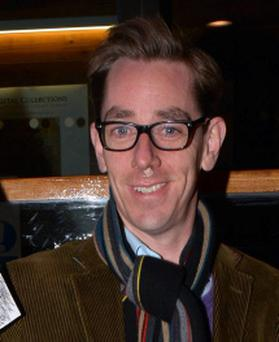 Ryan Tubridy held The Beatles 'Revolver' album in front of his face to prevent a close-up photo being taken of a small plaster on his upper-lip/nose area.