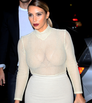KIM Kardashian opted to wear a nude mesh top that left little to the imagination on a night out in NY.