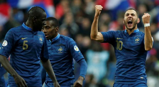 France's Karim Benzema (C) celebrates with teammates after scoring the second goal for the team during their 2014 World Cup qualifying second leg playoff soccer match against Ukraine at the Stade de France in Saint-Denis near Paris