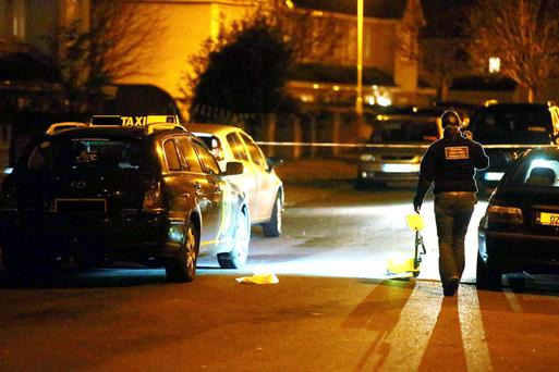 Gardai investigate the scene of the shooting on Dunsoghly Drive in Finglas, Dublin. Picture: Arthur Carron/Collins