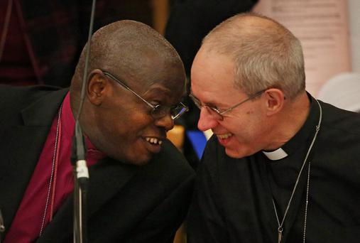 The Archbishop of York John Sentamu (L) talks to The Archbishop of Canterbury Justin Welby during the General Synod at Church House on November 20, 2013 in London