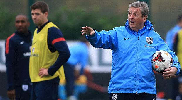 Tough call: Roy Hodgson's England could face several scenarios in Brazil