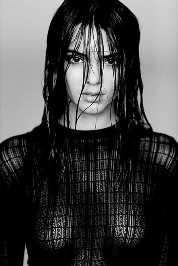 In the photo, reality TV star Kendall poses in a sheer black t-shirt top, her breasts visible. (Instagram/Kendall Jenner)